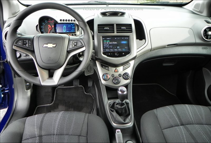 2014 Chevrolet Sonic 5DR LT interior front AOA800px clipped