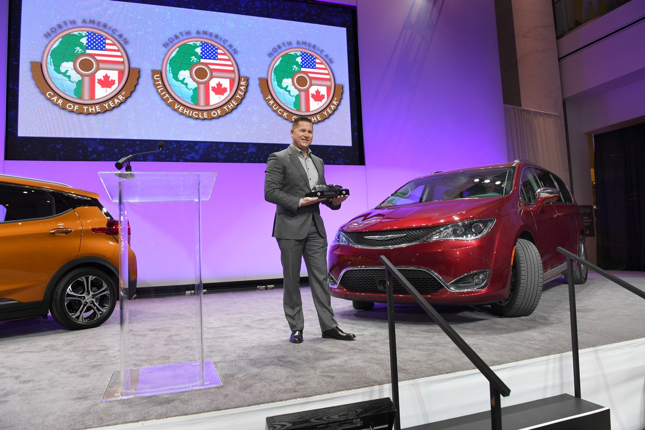 Timothy Kuniskis head of Passenger Car Brands for FCA holds the award for the Chrysler Pacifica minivan. The Pacifica was named North American Utility Vehicle of the year at the North American International Auto Show, Monday, January 9, 2017 in Detroit